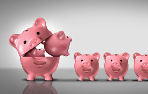 Business diversification concept as a financial growth strategy for new markets for investment growth as an open piggy bank with a group of smaller piggybanks as a metaphor for growing wealth or budget costs and inflation symbol.